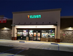 Outdoor image image of 7-11 showing main entrance and parking lot.